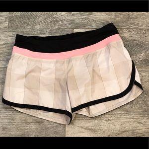 Black, White, and Pink Lululemon shorts, size 8